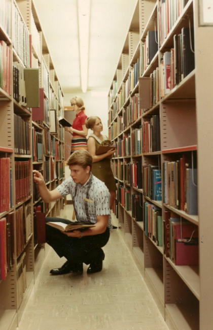 student in library back then in private christian college