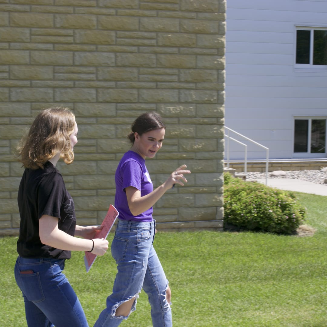 walking students in crown college campus