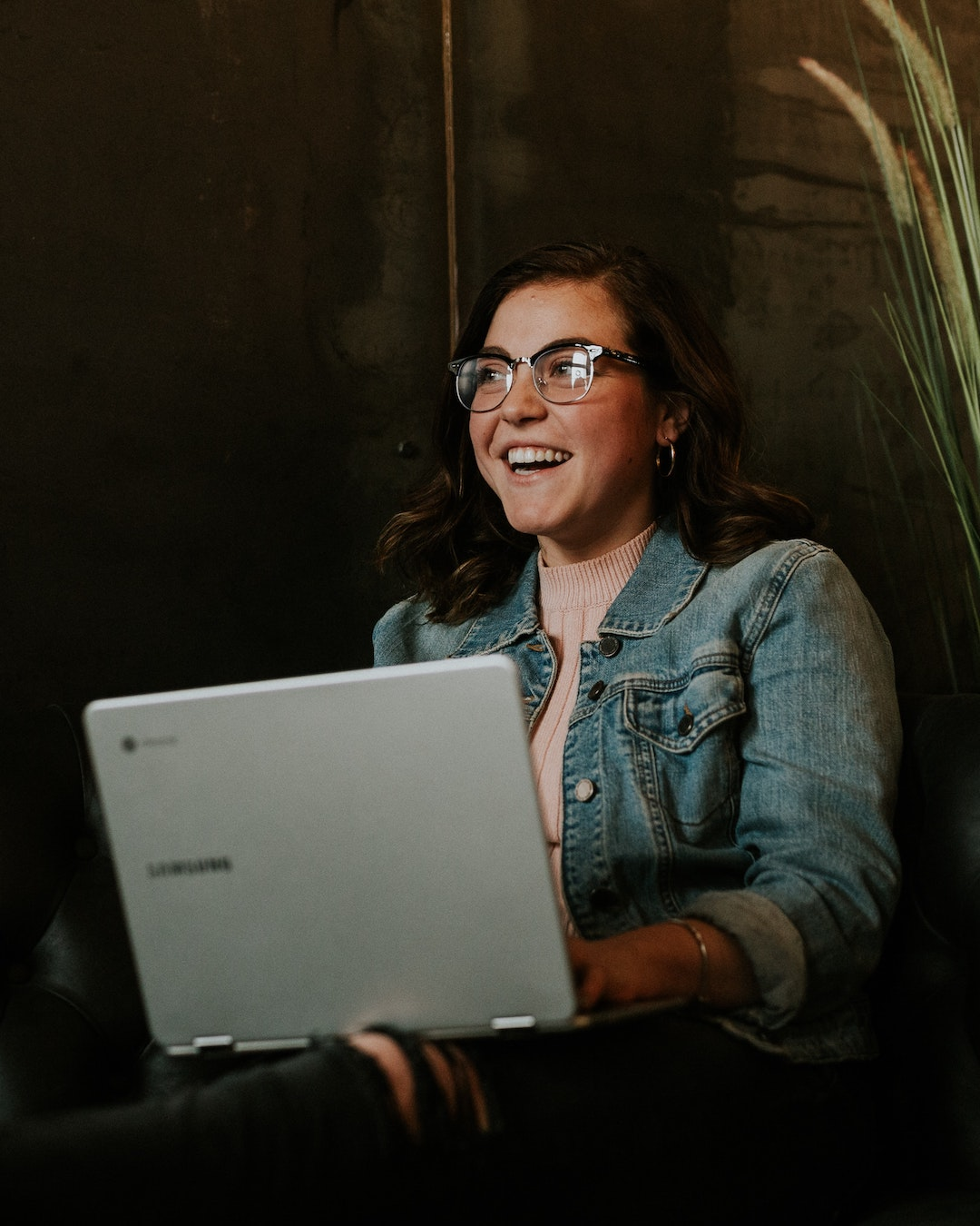 student with her laptop smiling at private christian college