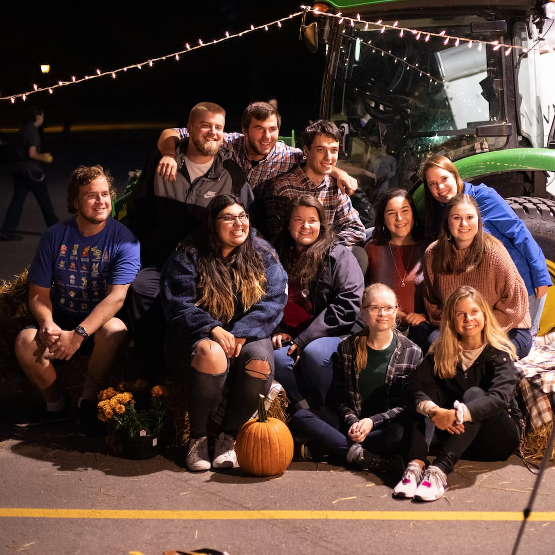 harvest party group gathers for picture a crown college event