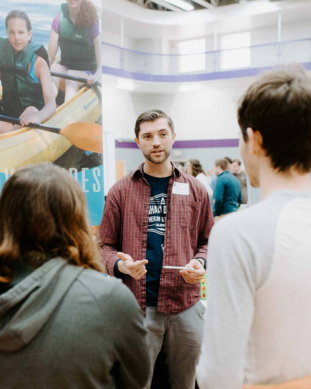male speaking to students for christian college degrees