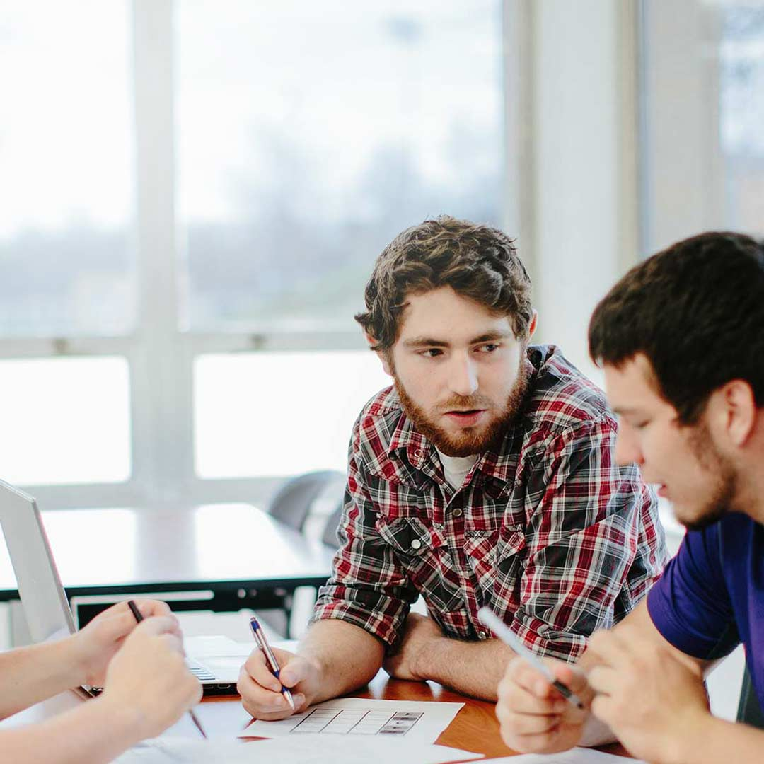 male student discuss in social justice degree