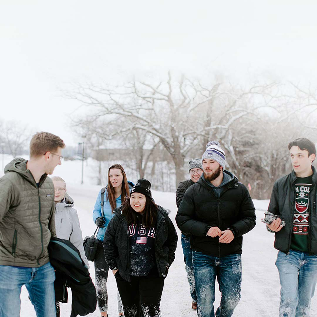 people outside in snowy day crown college admissions