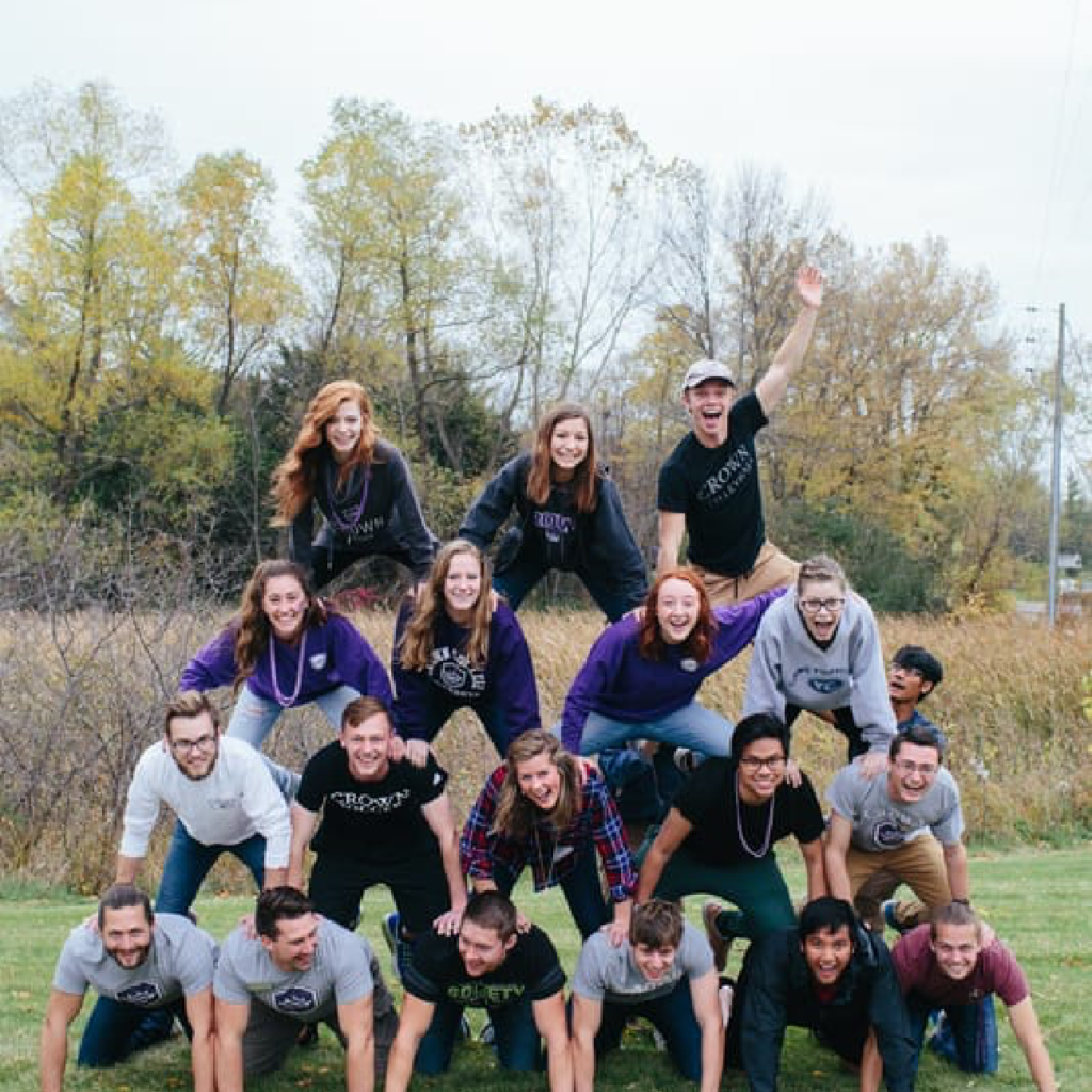 students make pyramid in crown college