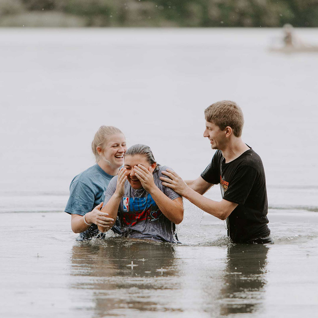 students baptizing other students in biblical studies degree online