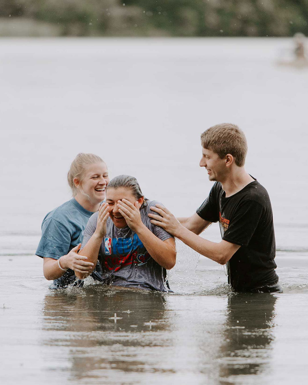 two students baptizing a student a pastoral leadership class