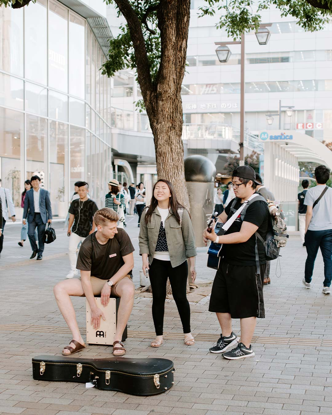 students playing music in japenese streets for bible study programs