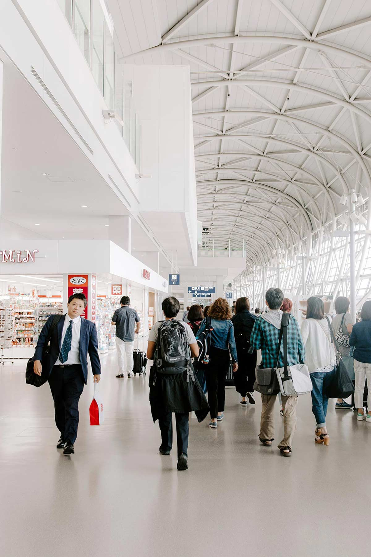 students walking in international airport for bible study programs