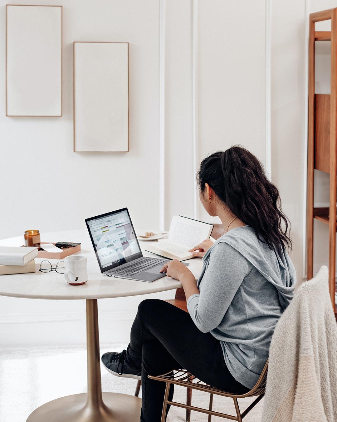 female working for online christian business degree