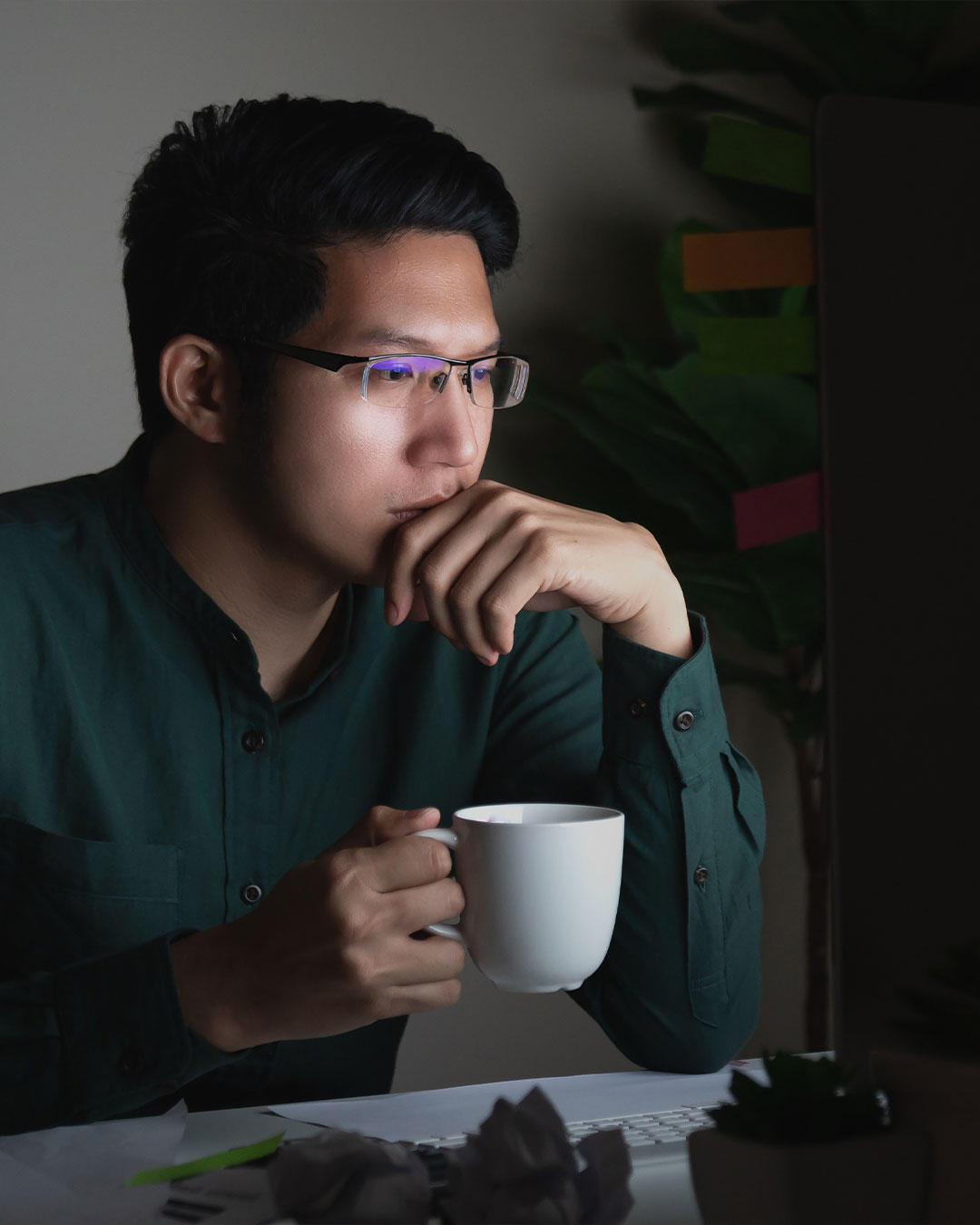 male staring at computer in biblical studies degree online