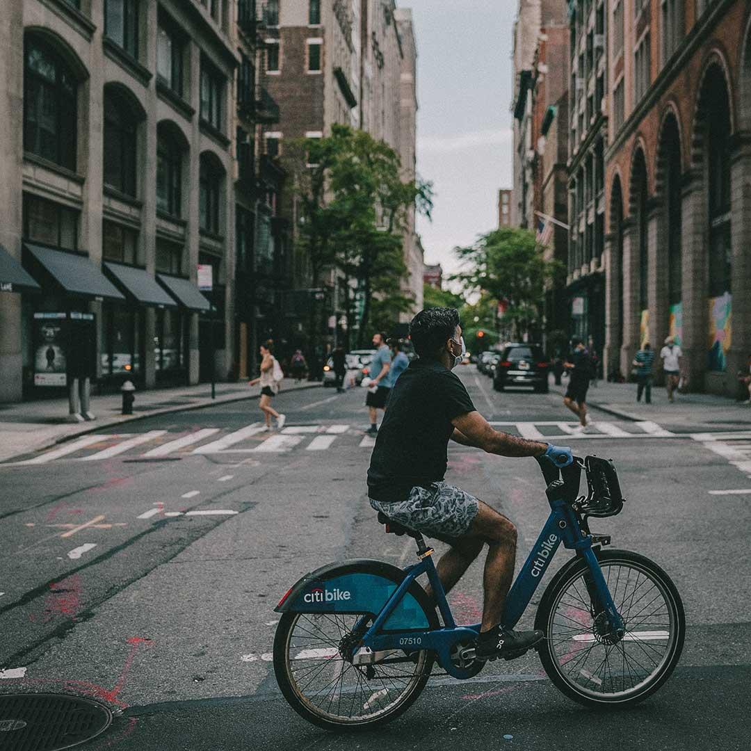 man riding bike in crown college