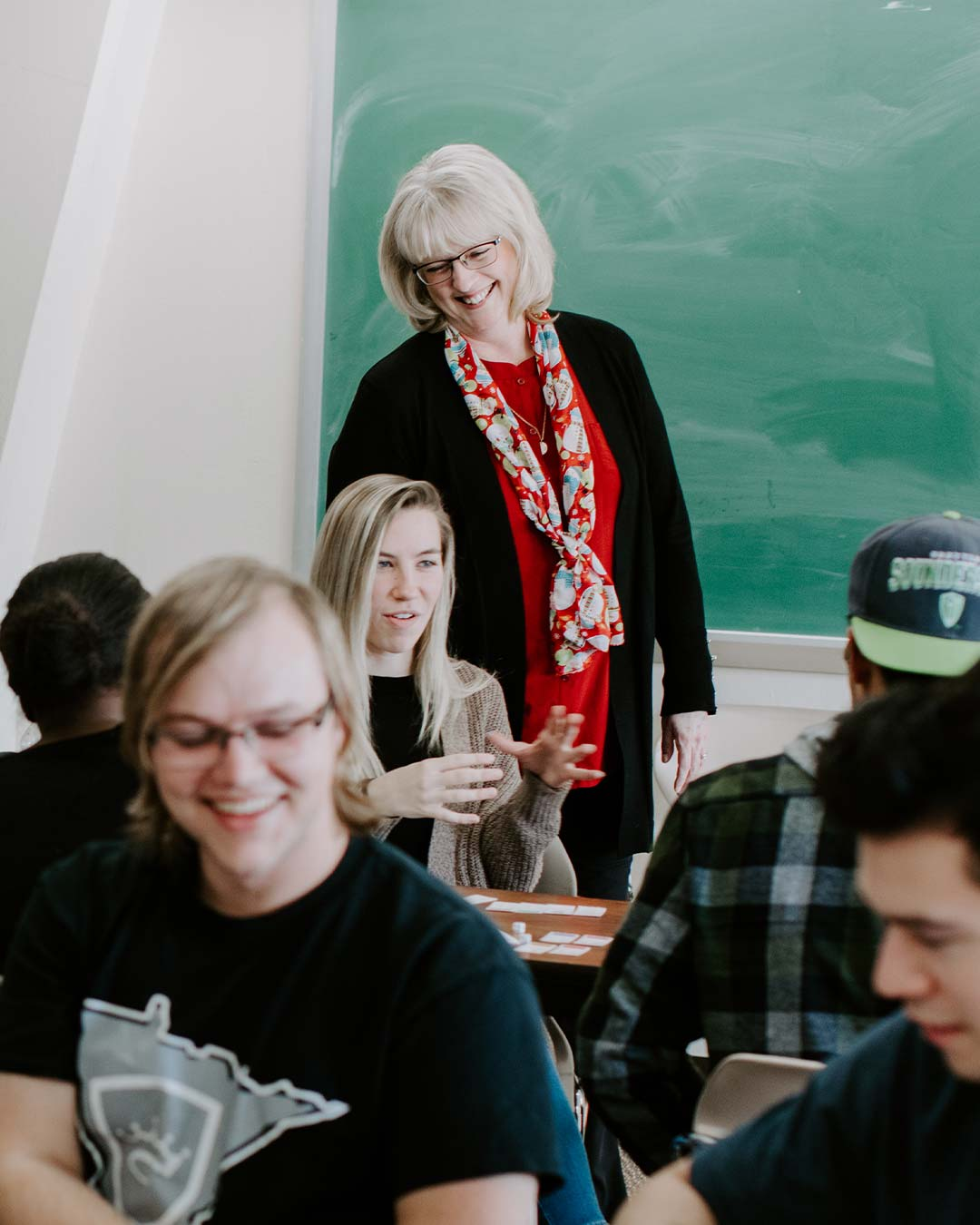 professor working with students online private christian college