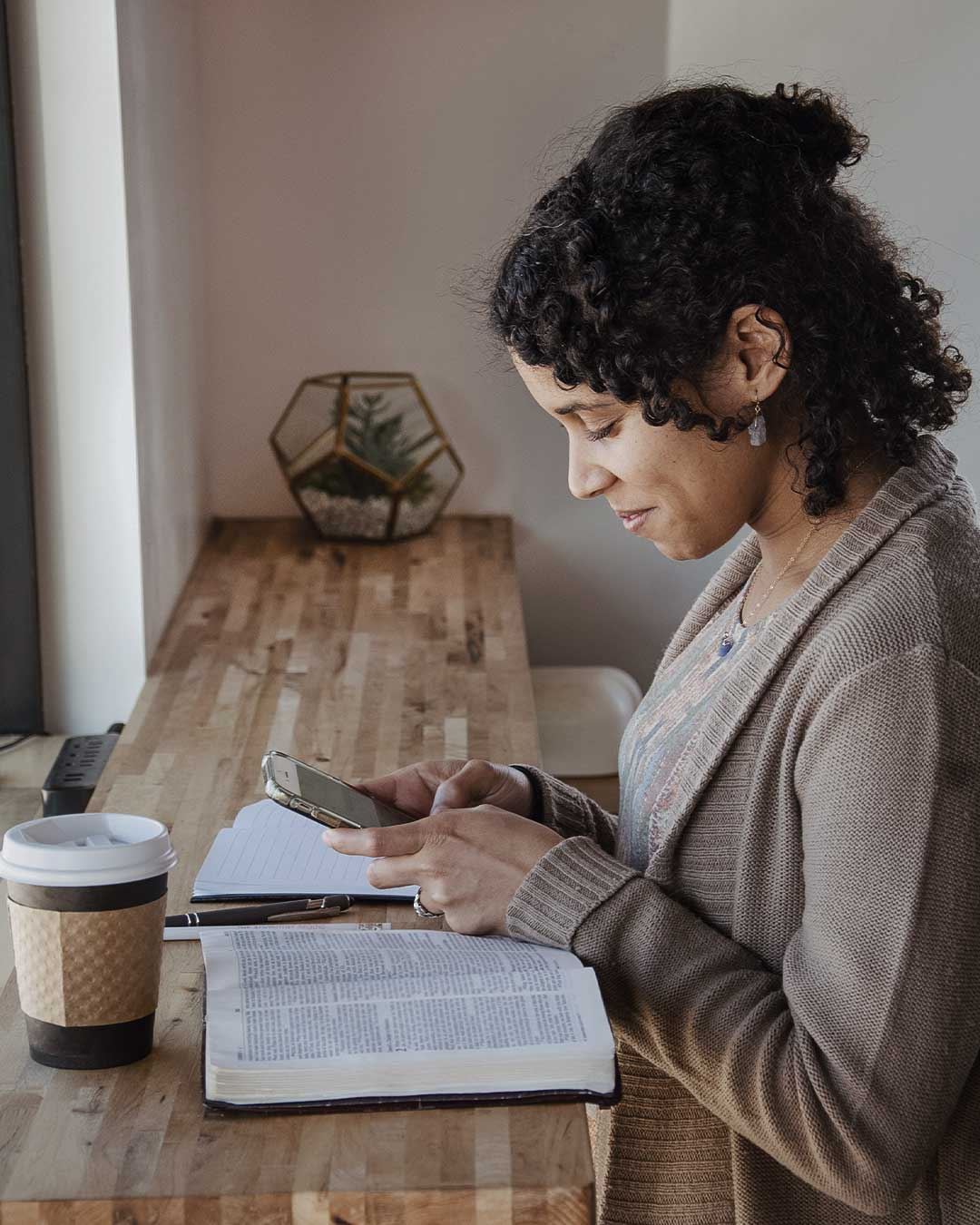 woman studying the bible in christian studies online class