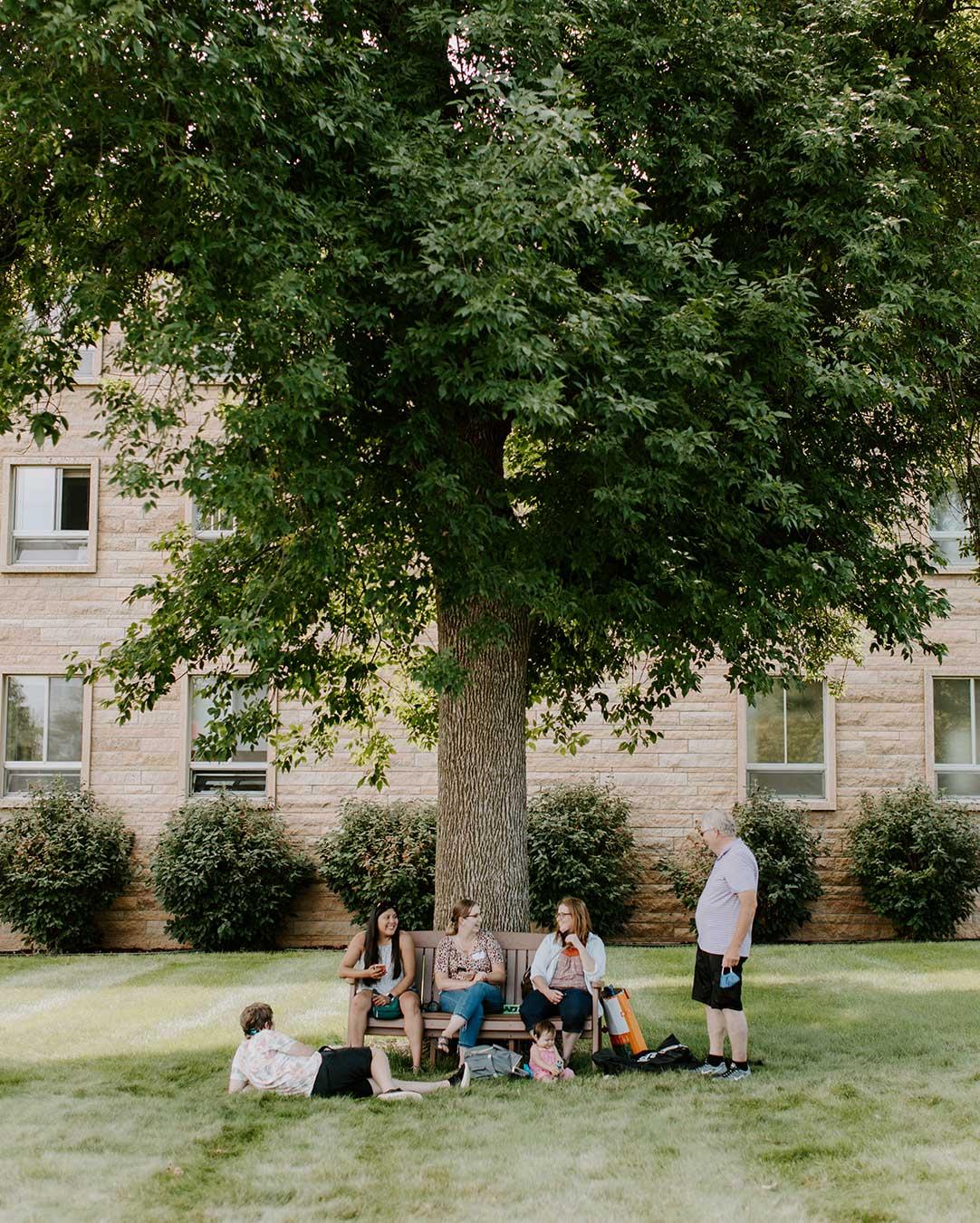 family_under_tree