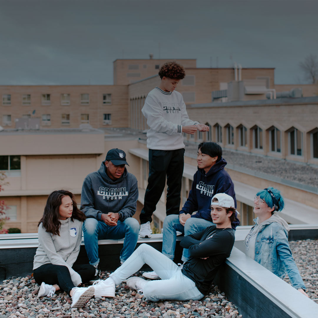 students_wearing_crown_merch